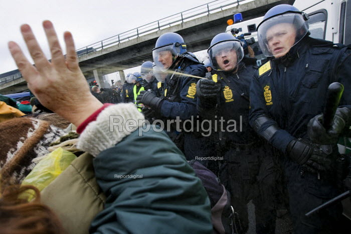 Protesters pepper sprayed by police. Reclaim Power! Push for Climate Justice! Protests outside the Bella Centre against COP15 United Nations Climate Change Conference, Copenhagen 2009, Denmark. - Jess Hurd - 2009-12-16
