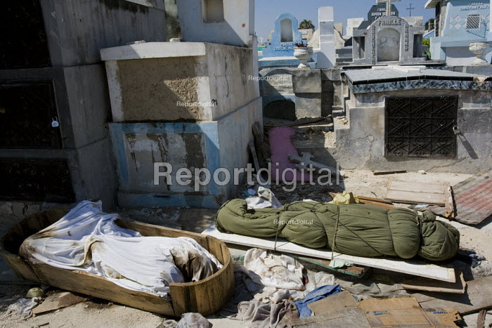 People leave dead bodies in the cemetery. Haiti earthquake. - Jess Hurd - 2010-01-18