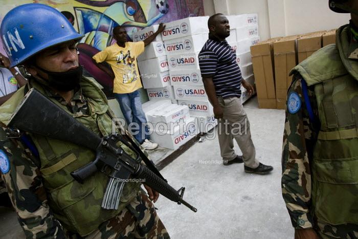 USAID under armed UN protection. Haiti earthquake. Port-au-Prince. Haiti. - Jess Hurd - 2010-01-18