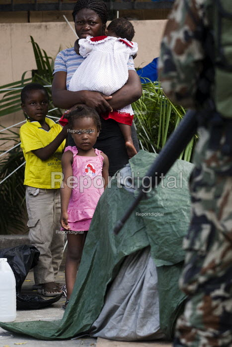 Earthquake refugee camp outside the TV Centre wait for US Aid, Sanitary items, which are protected by the Nepalese UN. Haiti earthquake. - Jess Hurd - 2010-01-19