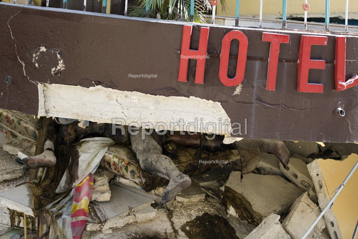 Dead bodies trapped between two floors. Haiti earthquake. - Jess Hurd - 2010-01-18