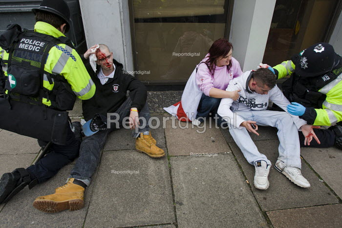 EDL supporters receive medical help from paramedics after rioting with police. English Defence League protest. Leicester. - Jess Hurd - 2010-10-09