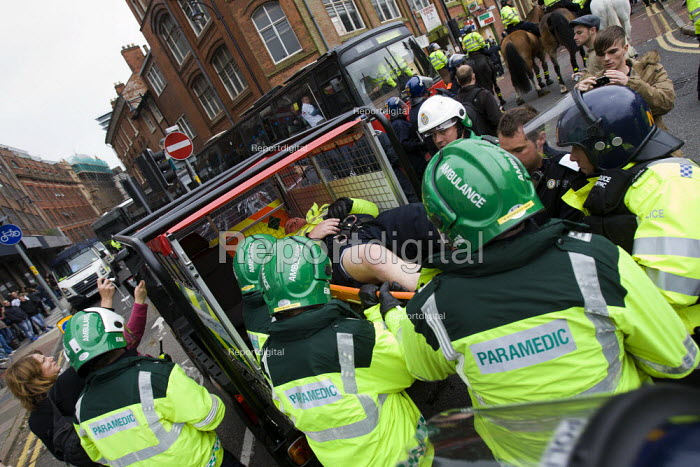 Injured police officer is stretchered away by paramedics in an ambulance. English Defence League protest. Leicester. - Jess Hurd - 2010-10-09
