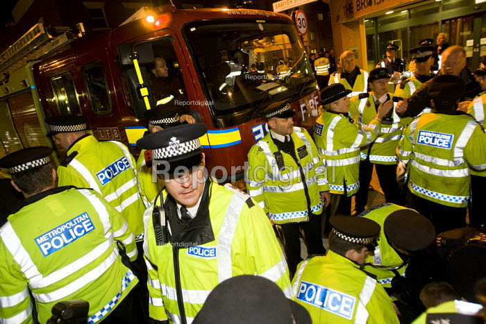 Ian Lehair, FBU NEC member for London is run over by a scab fire engine. FBU members picket the LFB Southwark Training Centre where scab firefighters are returning from strikebreaking. South London. - Jess Hurd - 2010-11-01