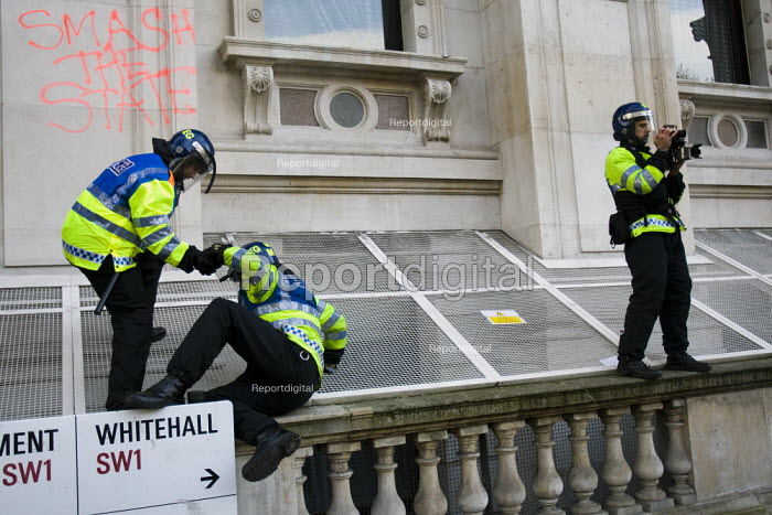 Police filming. Protest against education cuts and increased tuition fees, Whitehall London. - Jess Hurd - 2010-11-24
