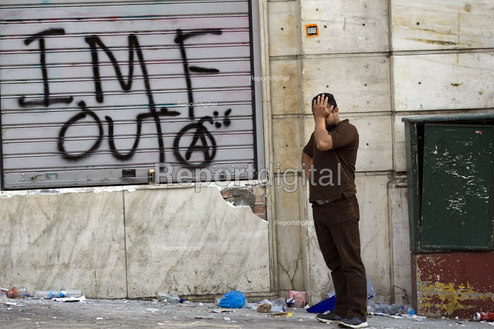 Anarchist graffiti, IMF out, during a general strike against austerity cuts. Syntagma Square, Athens, Greece. - Jess Hurd - 2011-06-15