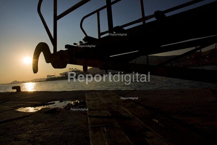 Chinese Cosco Pacific Ltd dock on the horizon. Piraeus, the main port in Athens. Greece. - Jess Hurd - 2011-06-17