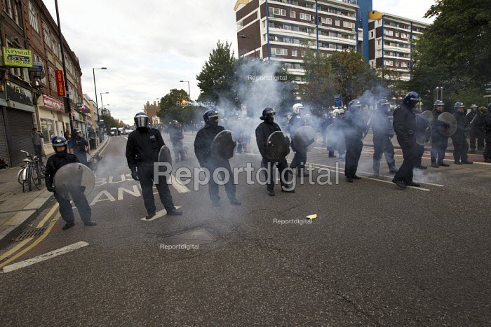 Fireworks are thrown at the police as riots spread to Hackney following a fatal police shooting. Riot police struggle to maintain order as rioting spreads across the country after Mark Duggan, 29, was killed. East London. - Jess Hurd - 2011-08-08