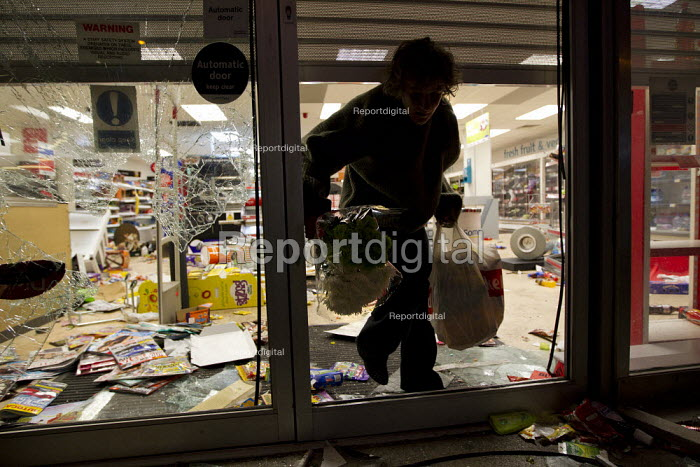Somerfield is looted, person carries out flowers. Riots spread to Crydon following a fatal police shooting. Riot police struggle to maintain order as rioting spreads across the country after Mark Duggan, 29 was killed in East London - Jess Hurd - 2011-08-08