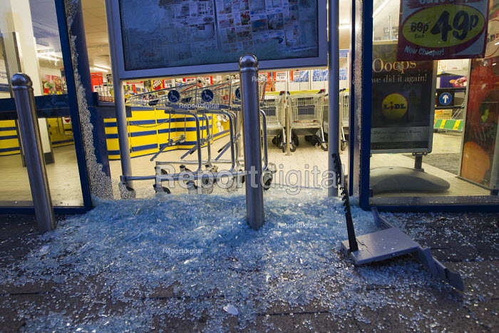 A smashed up Lidl as riots spread to Croydon following a fatal police shooting. Riot police struggle to maintain order as rioting spreads across the country after Mark Duggan, 29, was killed. East London. - Jess Hurd - 2011-08-08