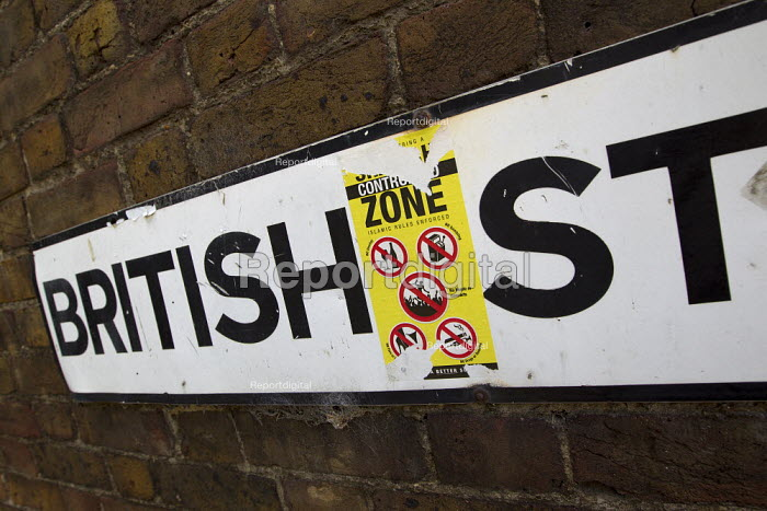 Muslims Against Crusades stickers in East London declaring You are entering a Sharia controlled zone Islamic rules enforced. With symbols representing no drugs, no smoking, no alcohol, no pornography, no gambling, no music or concerts. British Street. Tower Hamlets. - Jess Hurd - 2011-08-28