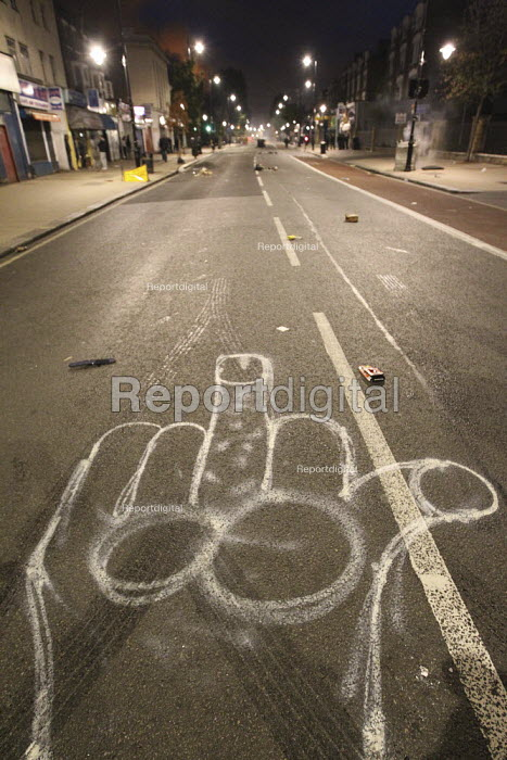 "Anti police graffiti. Violence erupts in Tottenham after a protest demanding ""justice"" over a fatal police shooting. Riot police clashed with hundreds of rioters after Mark Duggan, 29 was killed on Thursday. North London. - Jess Hurd - 2011-08-07"