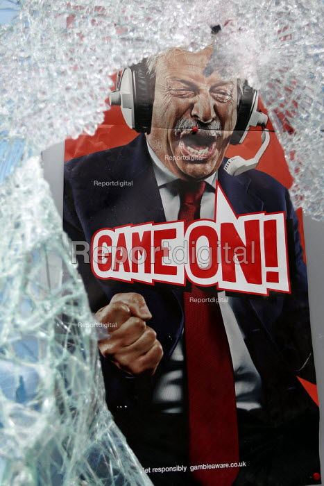 Smashed shopwindow of a betting shop. Riots in Tottenham. Riot police clashed with hundreds of rioters after the fatal shooting of Mark Duggan, 29, who was killed by police on Thursday. North London. - Jess Hurd - 2011-08-07