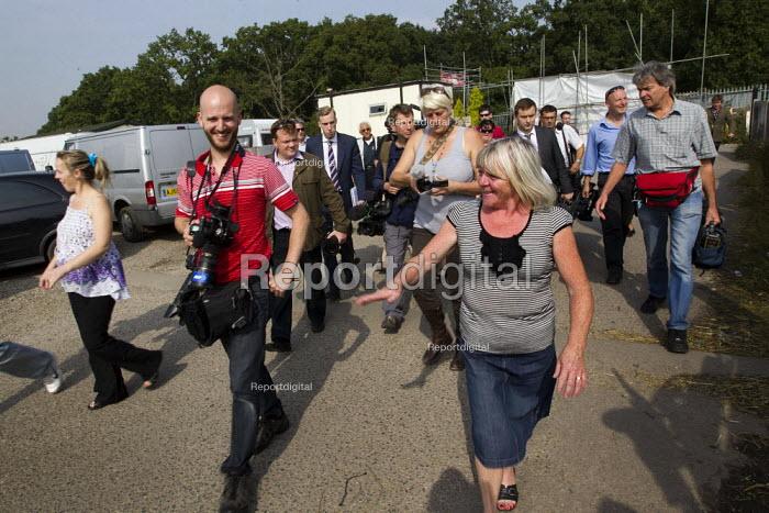 Kathleen McCarthy escorts the assembled media to a press conference. Basildon, Essex. - Jess Hurd - 2011-09-02