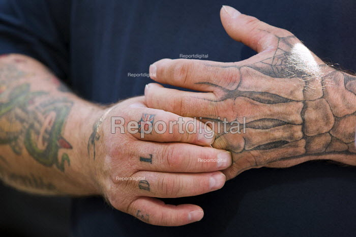 Tattooed English Defence League member at Liverpool Street before police escort them to Aldgate underground station for a rally. - Jess Hurd - 2011-09-03