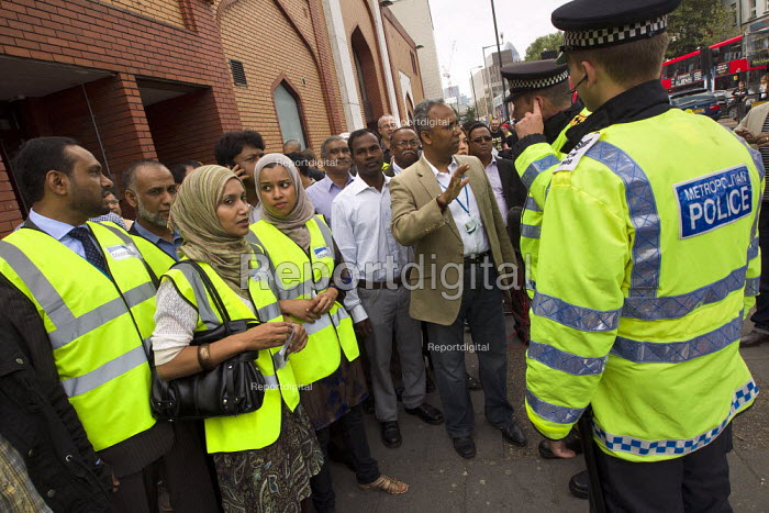 The Mayor of Tower Hamlets, Lutfur Rahman and local councillors talk with police outside the East London Mosque. English Defence League attempt to march in Tower Hamlets is stopped by a state ban and the mobalisation of local people by Unite Against Fascism. Whitechapel, East London. - Jess Hurd - 2011-09-03