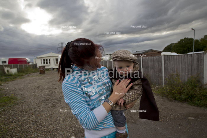 Maria and her son look around the empty plots as they prepare to leave Dale Farm ahead of the eviction by Basildon Council. Essex.   � - Jess Hurd - 2011-09-17
