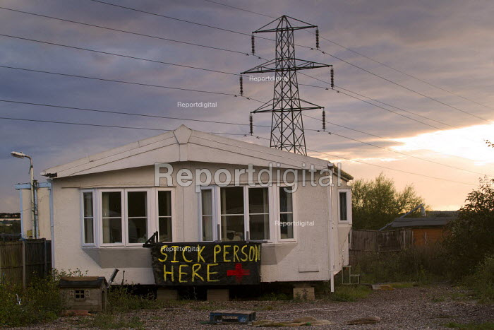 Sick person here. Travellers from Dale Farm on the eve of eviction by Basildon Council. Essex. - Jess Hurd - 2011-09-18