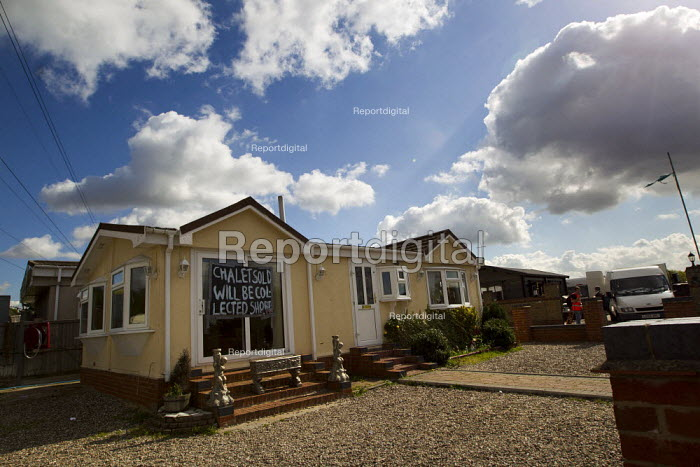 Chalet sold will collected shortly. Travellers from Dale Farm on eviction day. Basildon, Essex. - Jess Hurd - 2011-09-19