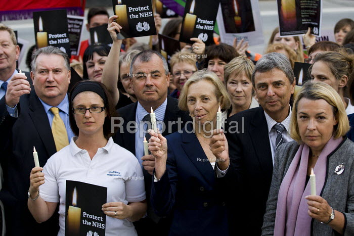 Candlelit vigil in Westminster as the Health and Social Care Bill passes in the Commons. NHS staff join union leaders including TUC GS Brendan Barber, UNISON GS Dave Prentis, Royal College of Midwives GS Cathy Warwick, Unite GS Len McCluskey and Director of Employment Relations at the Chartered Society of Physiotherapy Lesley Mercer. London. - Jess Hurd - 2011-09-07