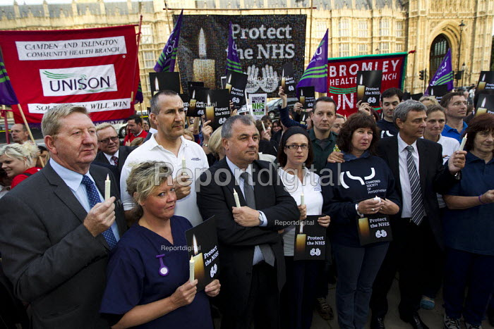 Candlelit vigil in Westminster as the Health and Social Care Bill passes in the Commons. NHS staff join union leaders including TUC GS Brendan Barber, UNISON GS Dave Prentis, Royal College of Midwives GS Cathy Warwick, Unite GS Len McCluskey, TUC Deputy GS Frances O �Grady, and Director of Employment Relations at the Chartered Society of Physiotherapy Lesley Mercer. London. - Jess Hurd - 2011-09-07