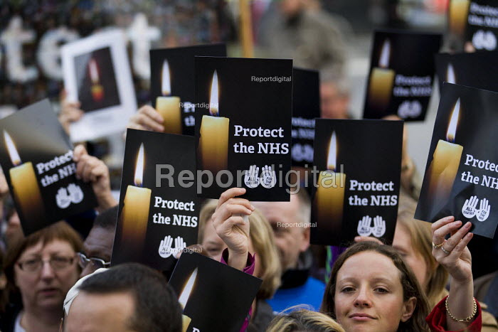 Candlelit vigil in Westminster as the Health and Social Care Bill passes in the Commons. Health workers hold candles and protect the NHS. London. - Jess Hurd - 2011-09-07