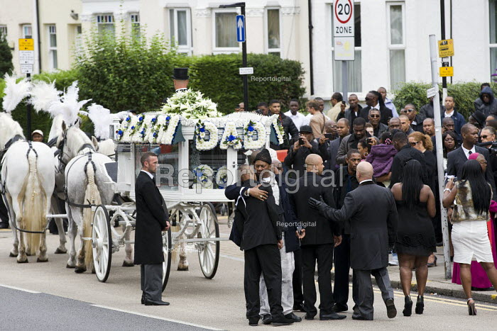 The funeral cortege of Mark Duggan who was killed by the police in Tottenham arrives at the New Testament Church of God, in Wood Green. North London. - Jess Hurd - 2011-09-09