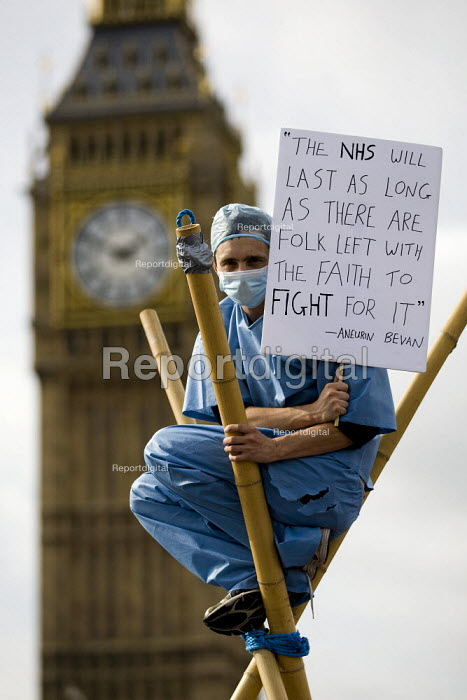 "A placard quoting Aneurin Nye Bevan: the NHS will last as long as there are folk left with the faith to fight for it"", Block the Bridge, Block the Bill, Uk Uncut against the NHS reform bill. Westminster Bridge, London. - Jess Hurd - 2011-10-09"