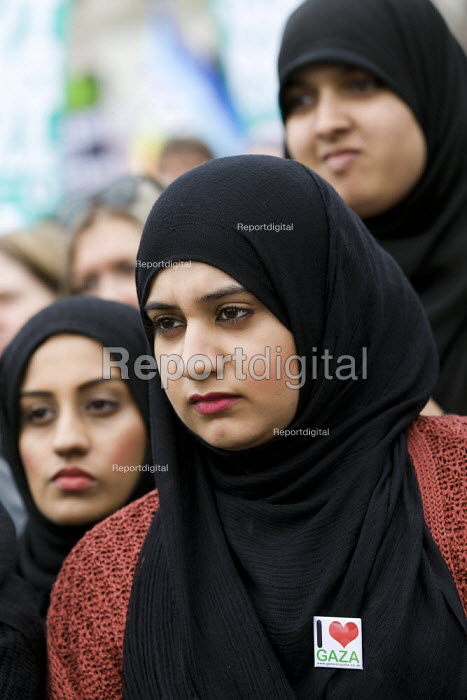 Muslim women with an I Love Gaza badge. Stop the War 10th Anniversary rally in Trafalgar Square. London. - Jess Hurd - 2011-10-08