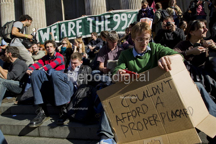 We are the 99%, I couldn't afford a proper placard. Occupy the London Stock Exchange against financial speculators and the banking crisis. St Paul's, London. - Jess Hurd - 2011-10-15