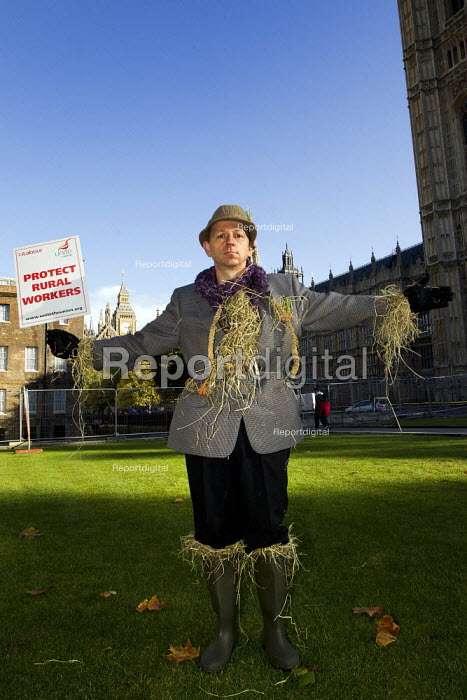Demonstration to defend rural workers and their livelihood against the abolition of the Agricultural Wages Board. Unite the Union scarecrow, Westminster, London. - Jess Hurd - 2011-10-25