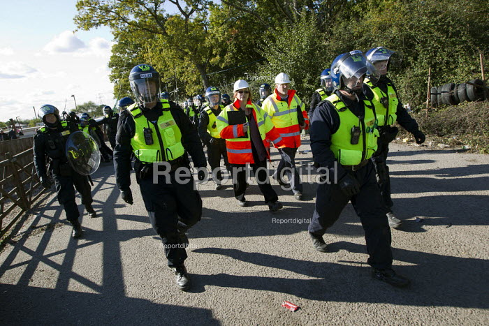 Council officials are escorted by riot police to inspect the site. Travellers from Dale Farm are evicted by bailiffs hired by Basildon Council. Essex. - Jess Hurd - 2011-10-20