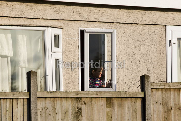 Mariah looks out of her trailer. Travellers from Dale Farm are evicted by bailiffs and police hired by Basildon Council. Essex. - Jess Hurd - 2011-10-20
