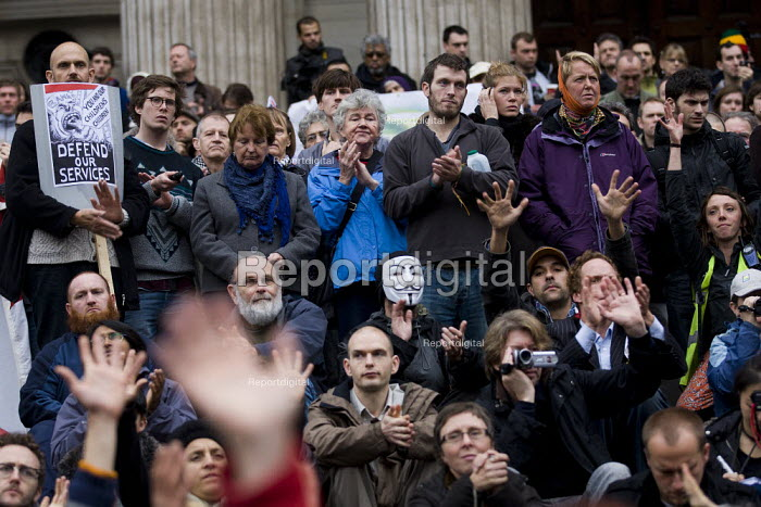 Waving hands. General Assembly at St Paul's Cathedral before Occupy LSX march to Parliament. London. - Jess Hurd - 2011-11-05