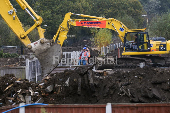 Constant & Co bailiffs and contractors bulldoze the plots at Dale Farm after Basildon Council evicted most of the traveller residents. Essex. - Jess Hurd - 2011-11-07