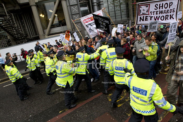 Police try to stop Electricians, plumbers and heating and ventilation engineers blocking the road as they hold a national day of protest to defend the skills and pay of construction workers. Balfour Beatty to cut wages by 35 and leave the JIB national pay and conditions agreement. London. - Jess Hurd - 2011-11-09