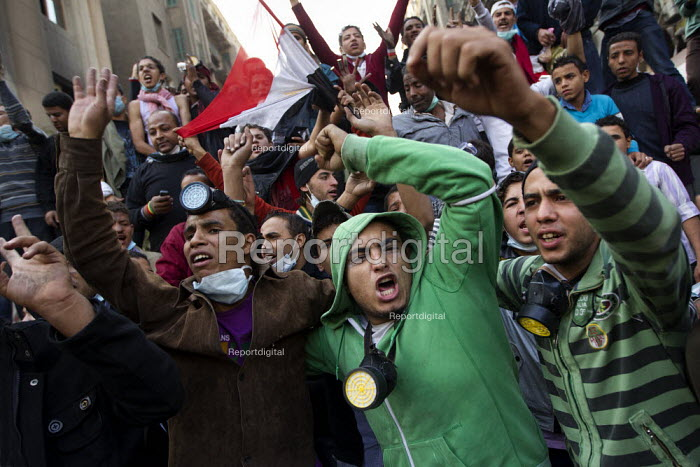 Protestors celebrate pushing back the police and military on Mohamed Mahmoud. Uprising against the military junta. Al-Tahrir (Liberation Square), Cairo, Egypt - Jess Hurd - 2011-11-23