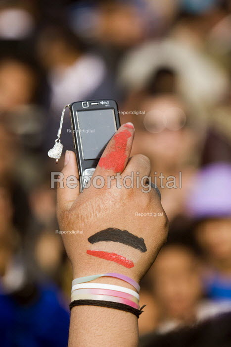 Scared hand of a protester recording with a mobile phone. Egyptian government elections begin as protests continue in Al-Tahrir (Liberation Square) against the military junta. Cairo, Egypt - Jess Hurd - 2011-11-28