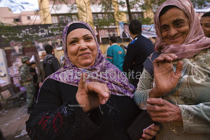 Women show their stained fingers which show they have voted. Police and military guard the polling stations as elections start in Cairo, Egypt. - Jess Hurd - 2011-11-28