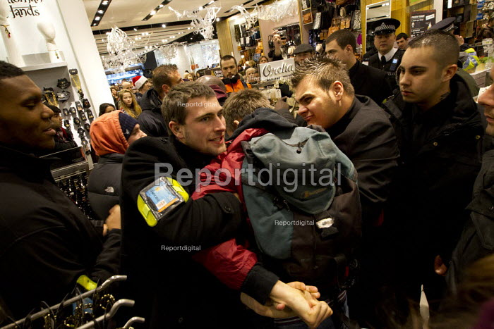 UK Uncut, the anti-austerity direct action group, demonstrates at high street stores of tax dodging companies. Topshop, Oxford Street. London. - Jess Hurd - 2011-12-17