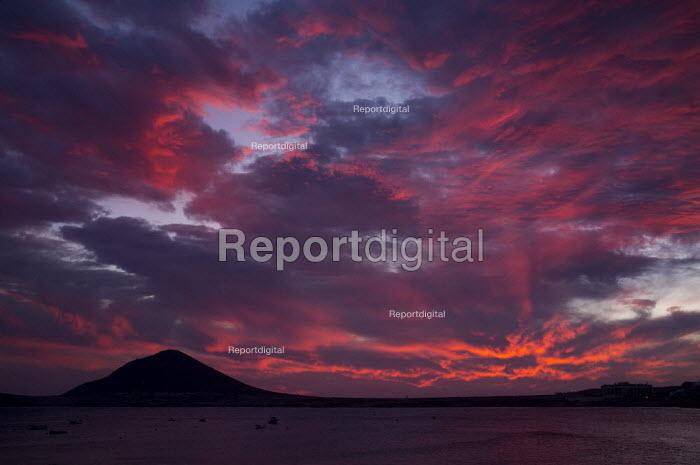 View of Montana Roja Red Mountain volcano from El Medano beach at sunset, Tenerife. - Jess Hurd - 2012-01-04