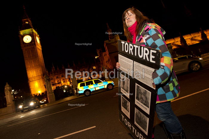 Torture. A Peace campaigner who has been camped in Parliament Square since 2005, has her tent removed by police, in Westminster, London. - Jess Hurd - 2012-01-16