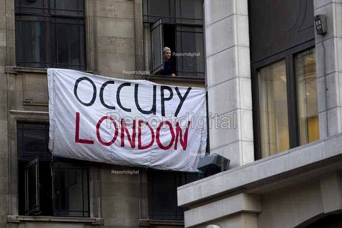 Occupy London protesters take over a branch of the Iraqi Rafidain Bank in London main financial district. The building turned to have foreign consulate status as the commercial attache building. City of London. - Jess Hurd - 2012-01-27