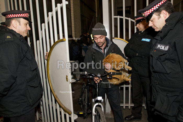 Occupy London protesters leave a derelict branch of the Iraqi Rafidain Bank in the main financial district London after being informed by police that commercial attache building actually had foreign consulate status. City of London. - Jess Hurd - 2012-01-27