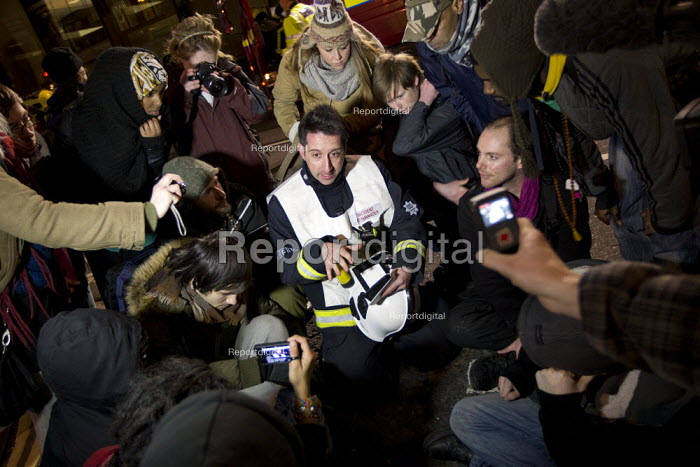 Comander speaking to protestors. Firefighters are sent to check the Iraqi Rafidain Bank City of London.. Incident Commander explains to Occupy London who had taken the building that it was unsafe and needed to be evacuated. City of London. - Jess Hurd - 2012-01-27