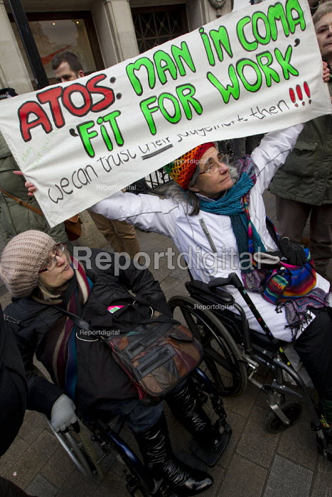 Disabled activists and UK Uncut protest oppose the Welfare Reform Bill. Disabled protesters chain themselves together at Oxford Circus. London. - Jess Hurd - 2012-01-28