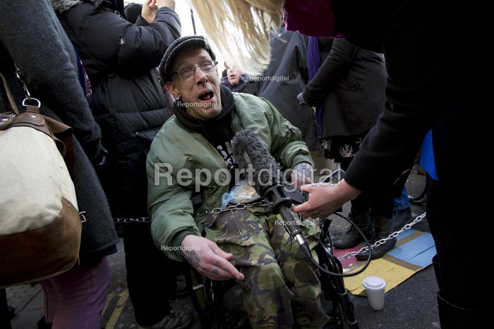 Disabled activists and UK Uncut join forces to oppose the Welfare Bill. Disabled protesters chain themselves together at Oxford Circus. London - Jess Hurd - 2012-01-28
