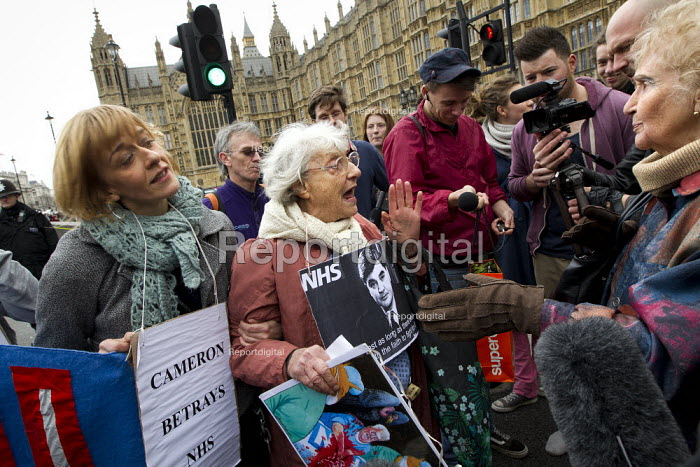 Tory woman argueing with 81 year old Shirley Murgraff an UK Uncut protesters who blocked the road outside the House of Lords against the NHS Bill. Westminster, London. - Jess Hurd - 2012-02-27