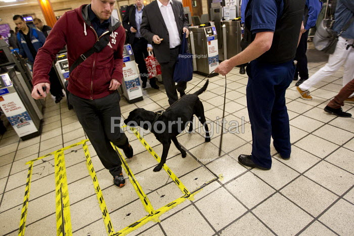 Drug sniffer dog with handler on the London Underground. Mobile police watchtower. Operation Trafalgar in West End London. Increased, visible policing is designed to tackle crime, disorder and anti-social behaviour. Piccadilly Circus. - Jess Hurd - 2012-03-29