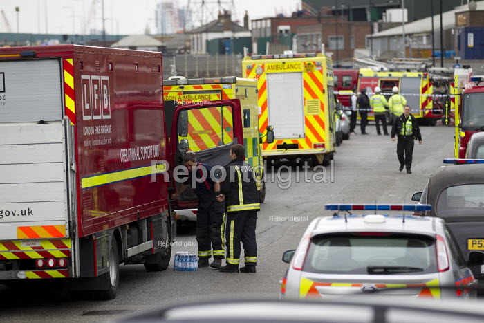 Police and firefighters attend a pallet fire on an industrial estate in Stephanson Street, Newham, East London. - Jess Hurd - 2012-04-05